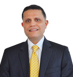 Dr. Minoo Patel